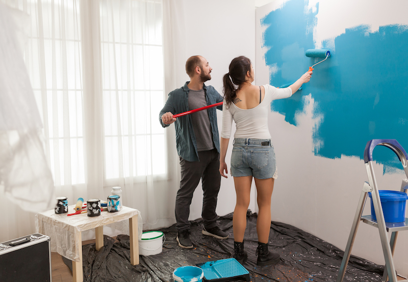 Painting wall using roller paint brush